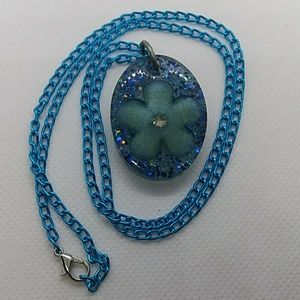 Resin pendant with blue flower